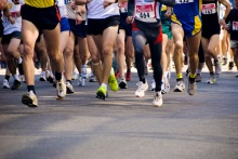 detail of the legs of runners at the start of a marathon race